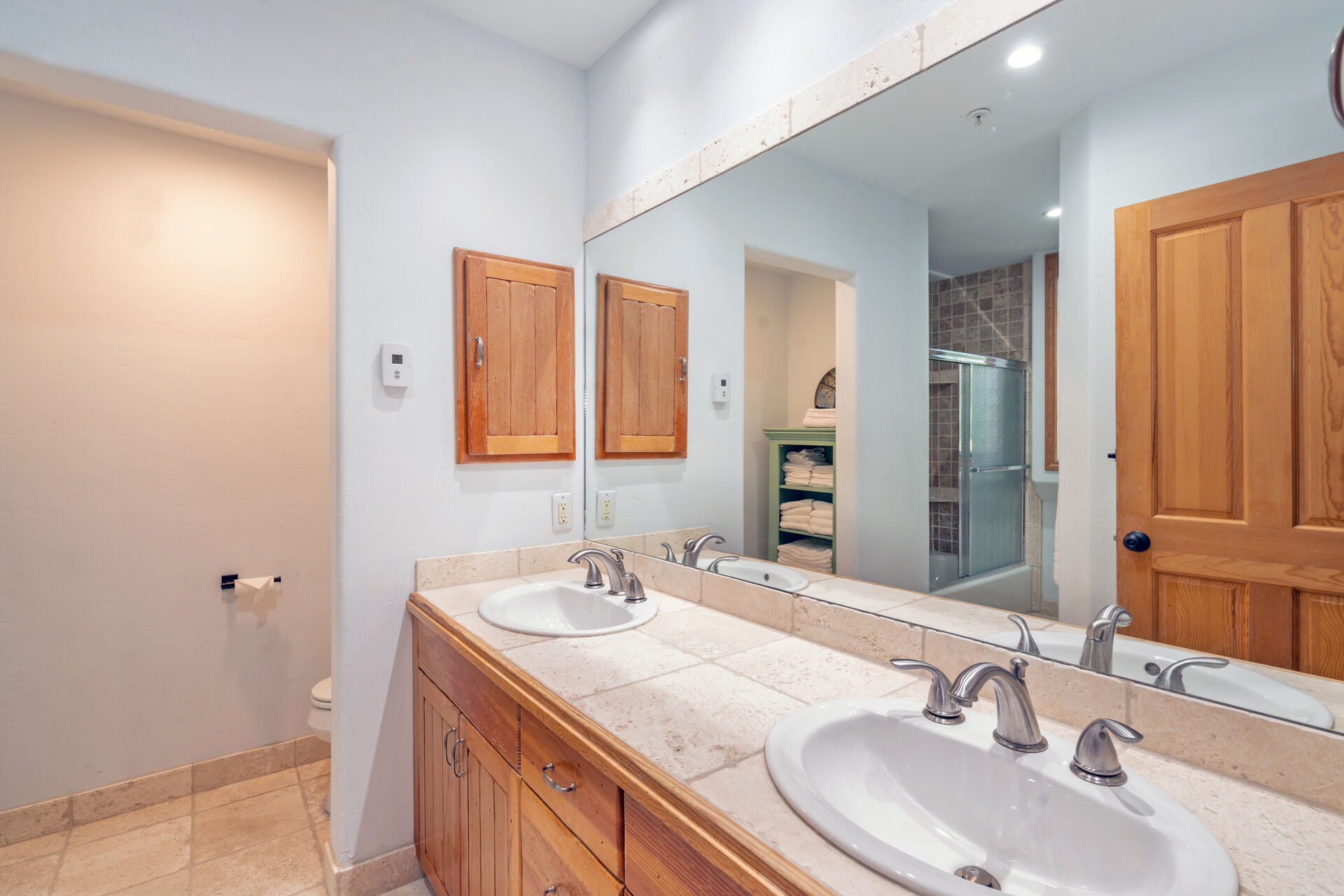 Bathroom with tile dual vanity counter
