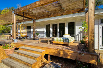 Lounge on the deck under the covered pergola and unwind