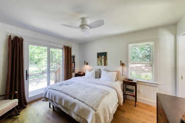 Master bedroom with sliding doors that lead to the backyard