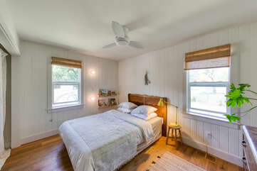 Soothing country-style bedroom awaits