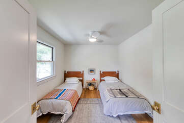This 2nd living space has two twin beds for made for relaxing, napping, and sleeping