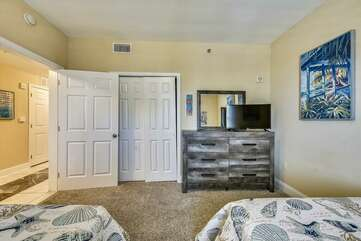 Second bedroom to the right as you enter the condo with full size beds. Plenty of dresser drawer and closet space