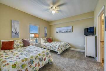 First bedroom to the left when walking into the condo with full size beds
