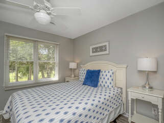 The first guest bedroom has a queen bed and access to the hall bath
