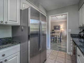 Large French door refrigerator and tile floors
