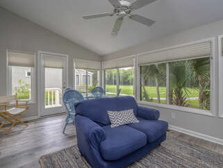 The sun porch has access to the grilling deck.