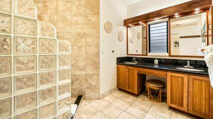 Primary bathroom with walk in shower, dual sinks