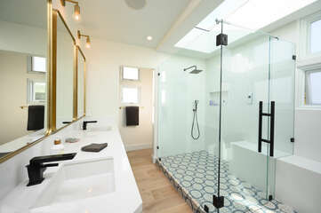 Large walk in shower with his and hers sinks.