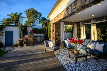 There is a built in BBQ on this lovely deck, perfect for the whole family.