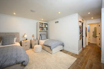 Downstairs bedroom with two twin size beds, a spacious walk in closet and en suite bathroom.