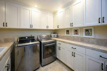 Laundry room features a full size washer and dryer