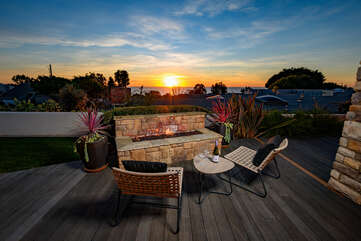 Enjoy a glass of wine at sunset on this patio with outside fire pit ocean view