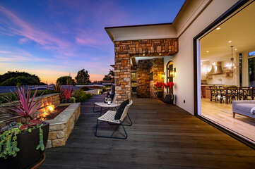 The indoors flow effortlessly in the front yard for a perfect night of relaxing by the fire