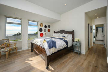 Master bedroom with a Cali king size bed with ocean view and large walk-in closet