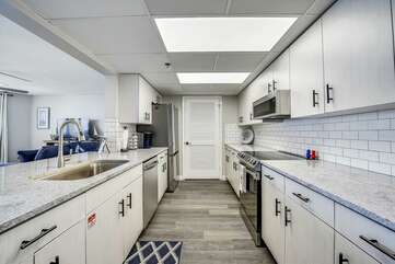 Tiled kitchen with laminate floors