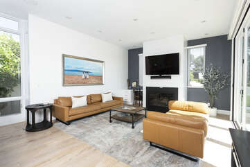This large living room has beautiful ocean views and a large panel of sliding doors.