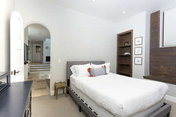 The second downstairs bedroom has a Queen bed and Smart TV with an en suite bathroom.