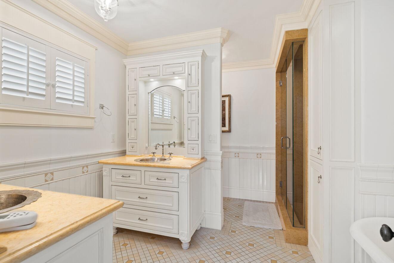 Master bathroom with his/her vanities