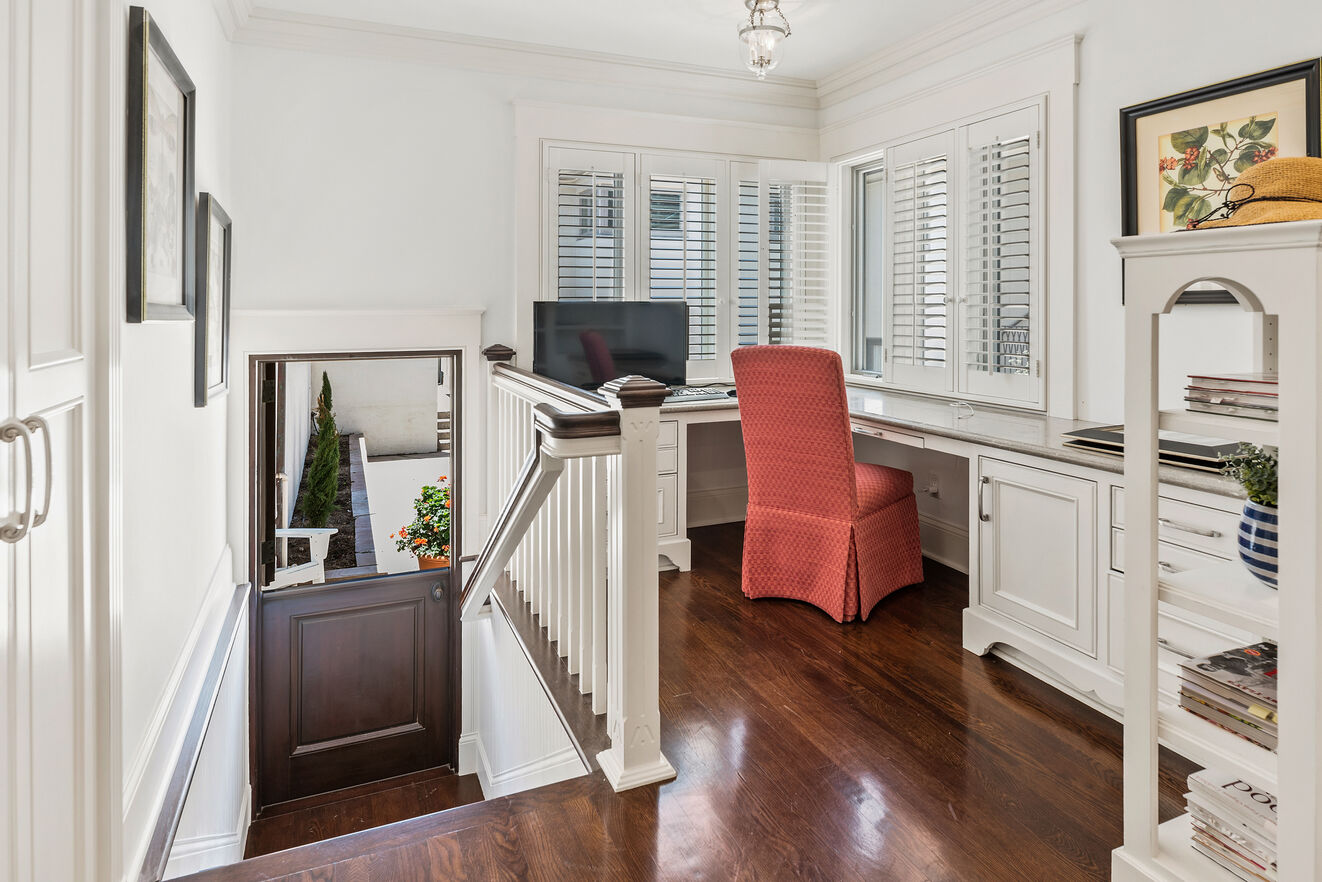 Office nook off the kitchen with ocean view and tv