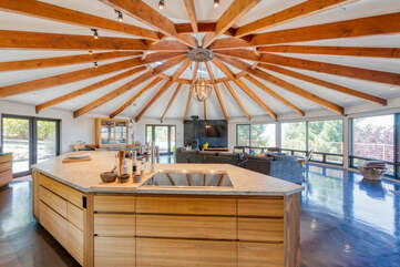Huge kitchen island with cooktop overlooking the views through the floor-to-ceiling windows