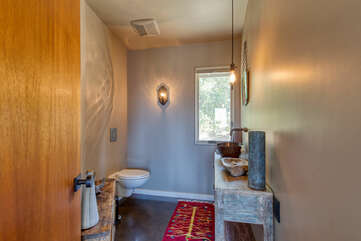 Simple, yet elegant and rustic half bath that's easily accessible from all rooms