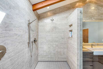 The large, open shower features two showerheads both with their own temperature controls
