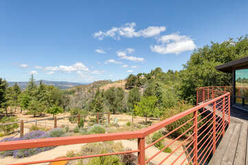 Overlook the 5 acre property and take in the private mountain views