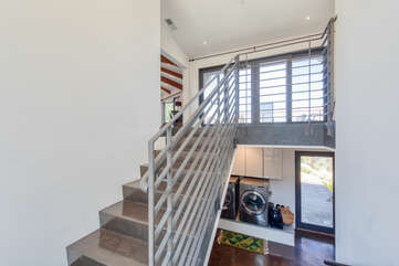 Modern staircase takes your from the main floor to downstairs