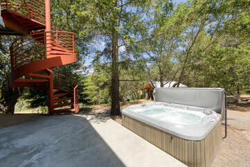 Access the hot tub from the spiral staircase off the upstairs deck or out the backdoor from downstairs