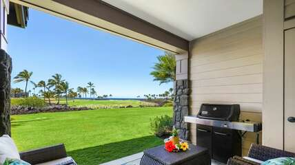 Golf course and Ocean Views from porch, with grill and seating.