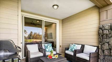 The front porch of this Halii Kai condo with seating for 4 and grill.