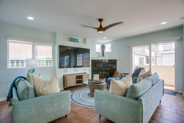Spacious Living Room w/ Large TV & Fireplace - 2nd Floor