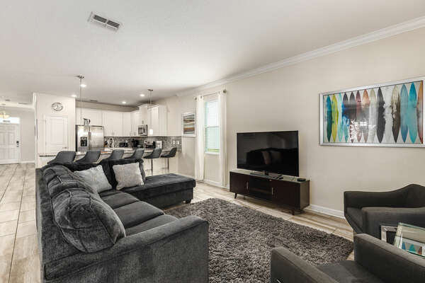 Sit back and unwind with your companions in the living area.
