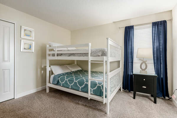 Another bedroom with a bunk bed set up
