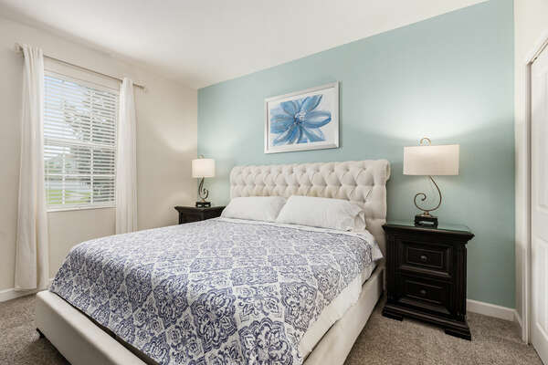 This bedroom comes with a king bed and minimalist design