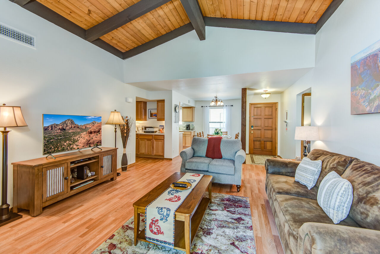 Living Room with Wood Floors and Vaulted Ceiling