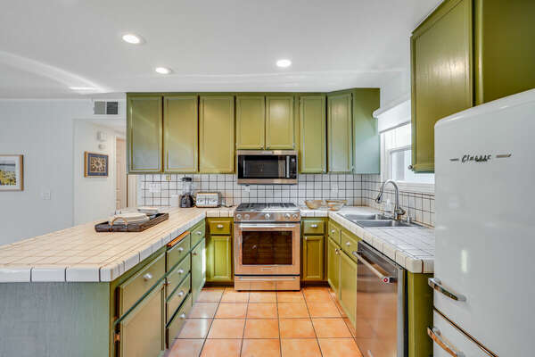 Fully Equipped Kitchen w/ Trendy Sage Green Cabinets & Classic Retro Fridge