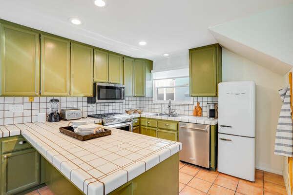 Kitchen w/ Trendy Sage Green Cabinets & Classic Retro Fridge