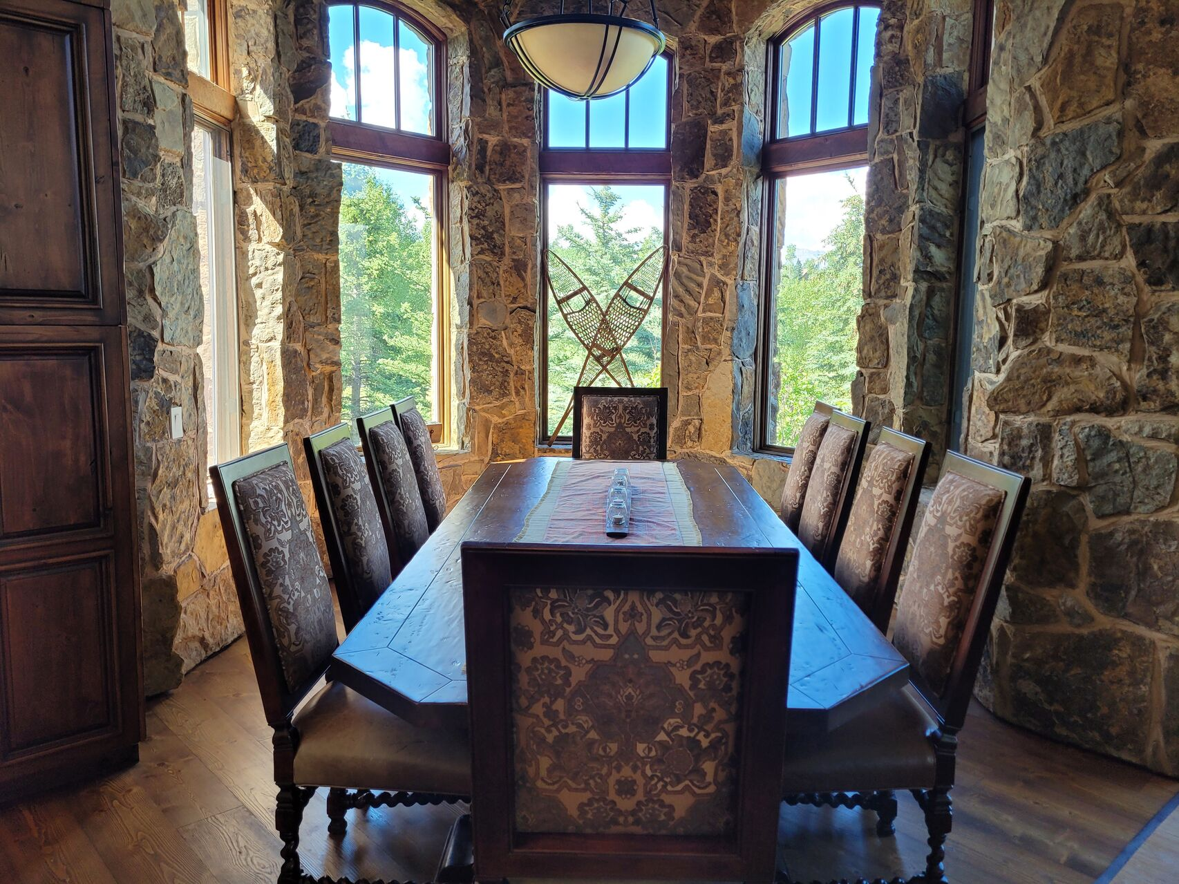 Luxury dining room with stone walls