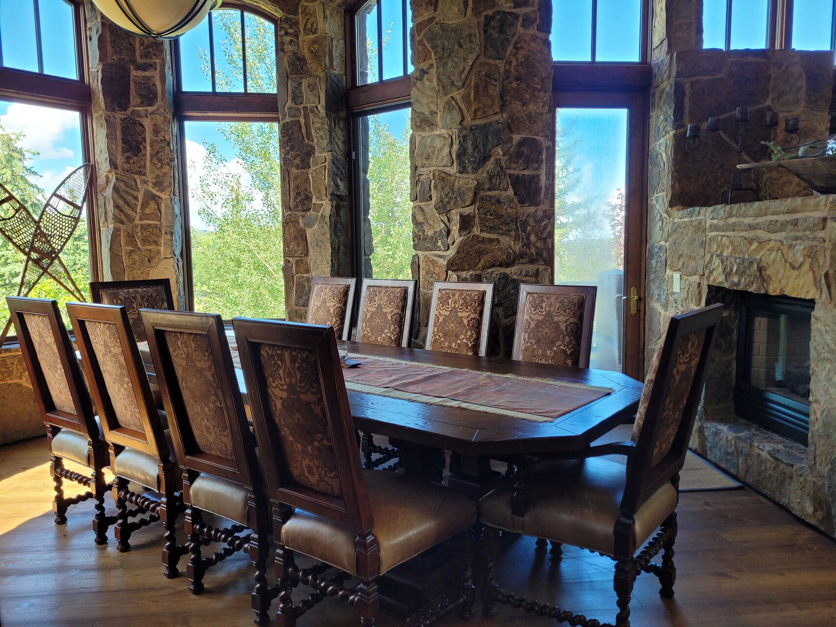 Luxury dining room with large table and stone walls