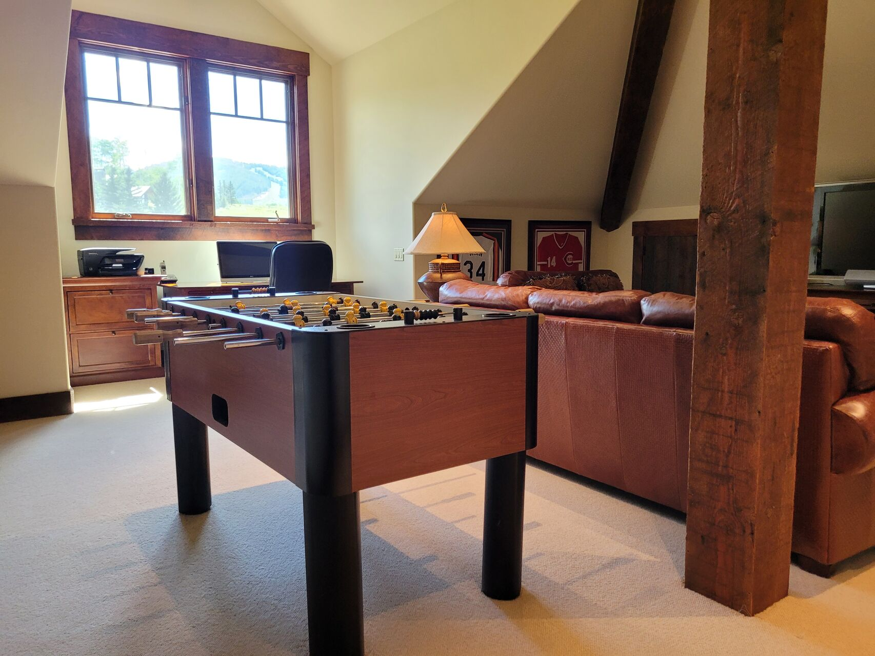 Game room with Foosball table and leather couches