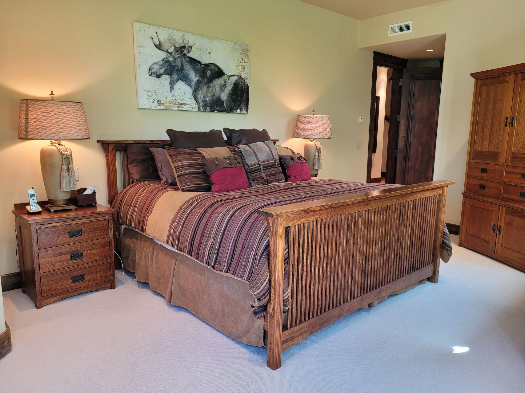 Large bed with wood frame and wood furniture