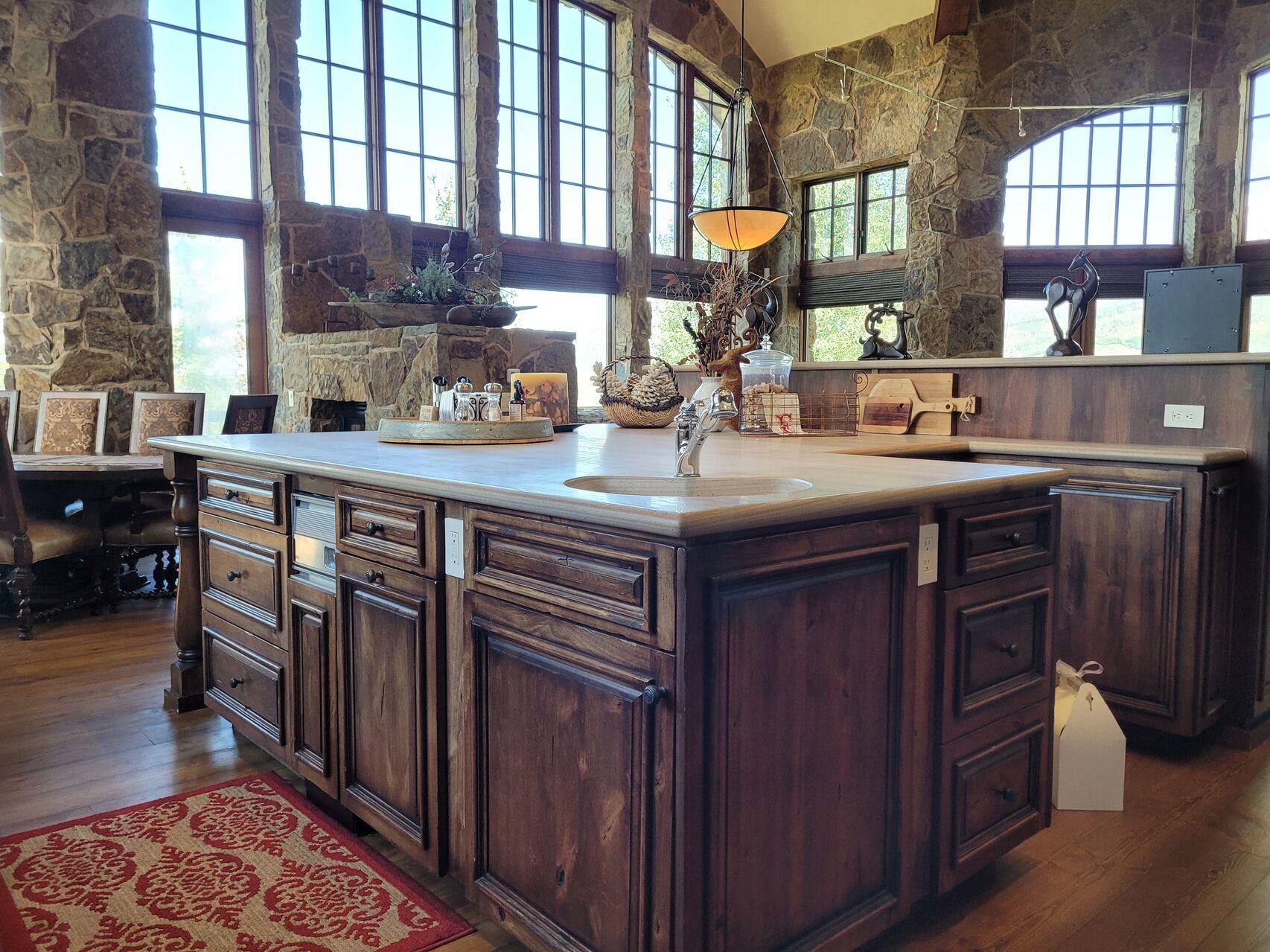 Large kitchen island with dark wood cabinets