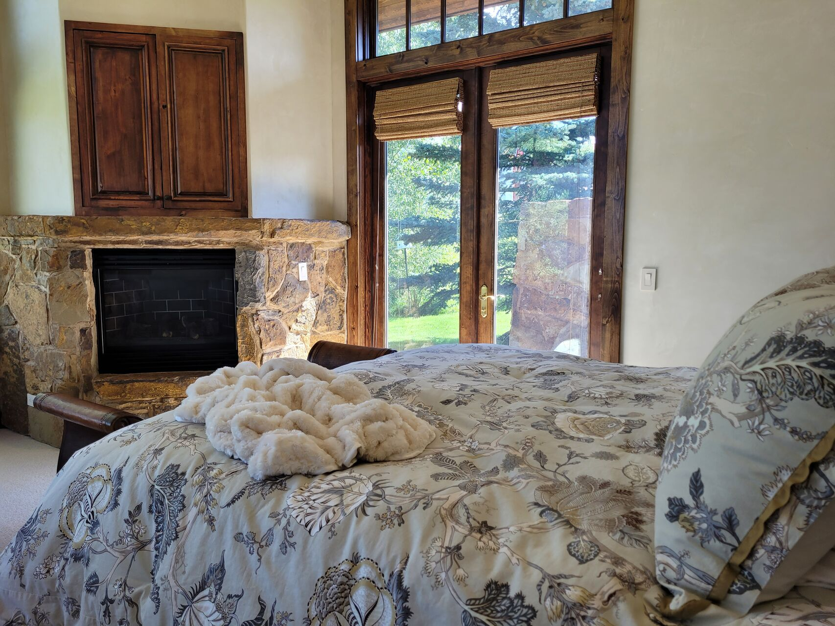 Bedroom with cozy bed and feature fireplace