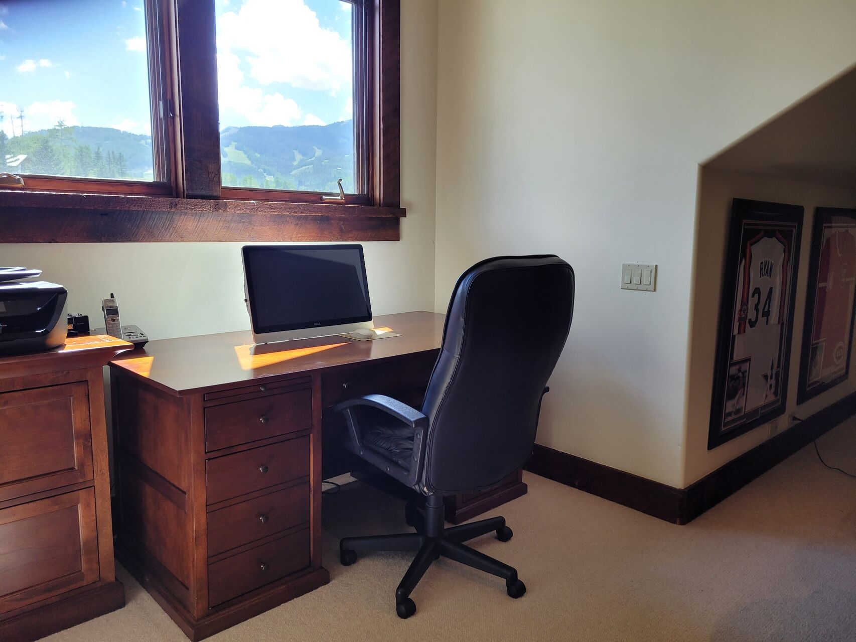 Office with wood desk and office chairs