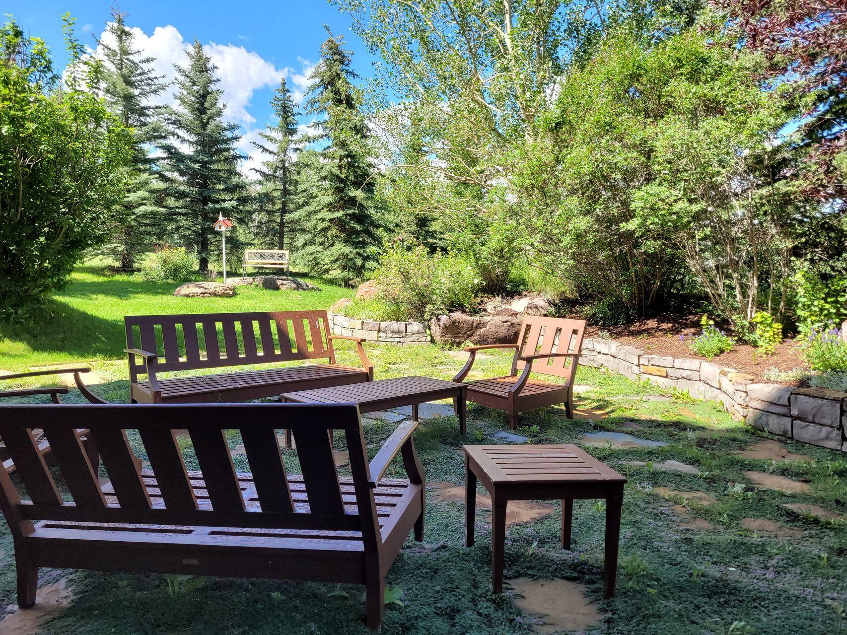Garden with wood outdoor furniture