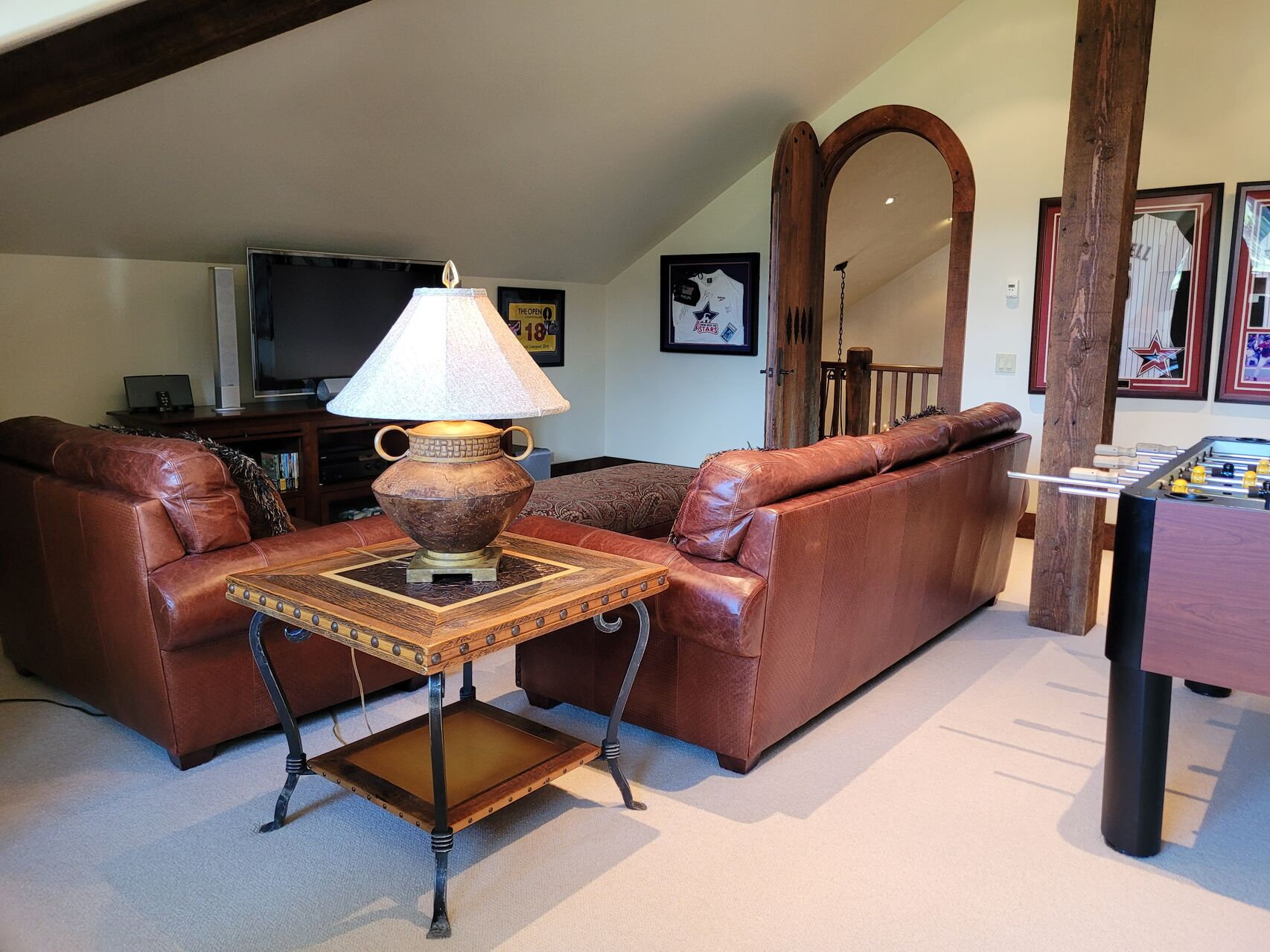 Living room with leather furniture and wood accents