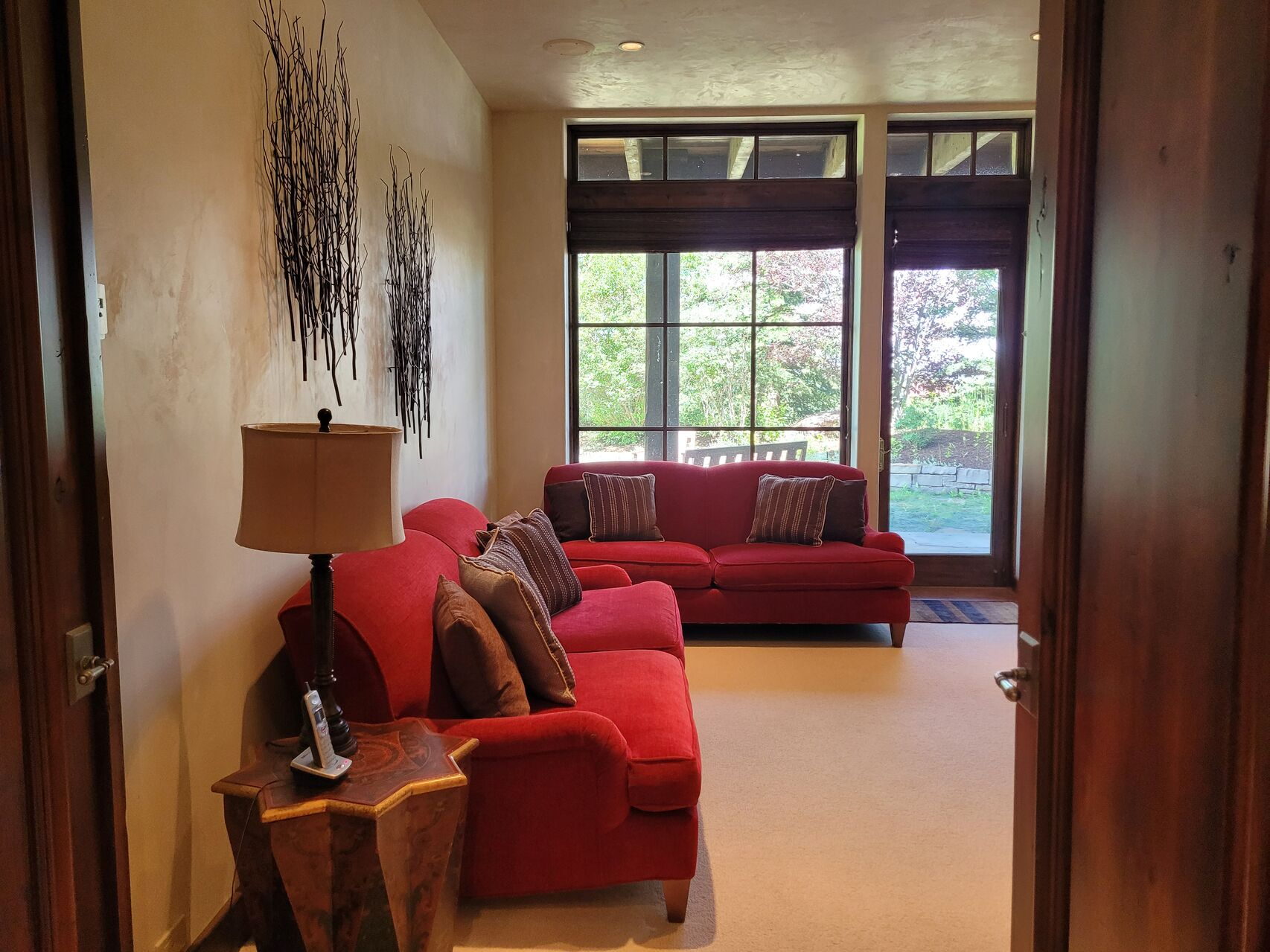 Living room with red couches and large window