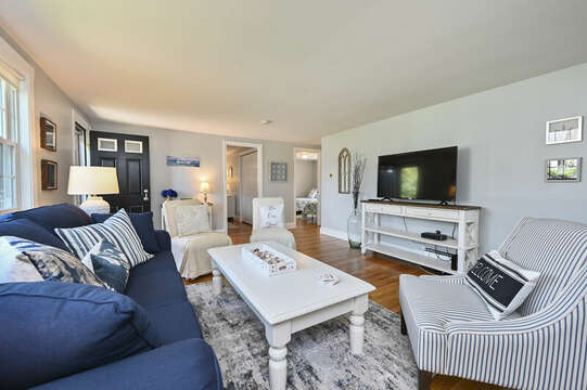 Living room with couch and 3 occasional chairs, flat screen TV - 113 South Street Harwich Port - Cape Cod - New England Vacation Rentals