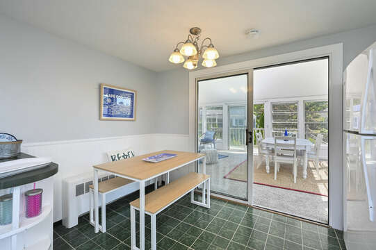 Kitchen with seating and fridge, slider to sun room - 113 South Street Harwich Port - Cape Cod - New England Vacation Rentals